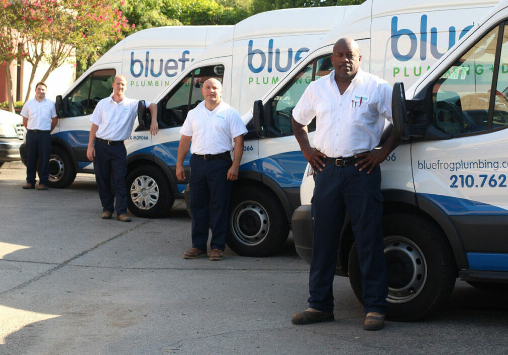bluefrog Plumbing + Drain plumbing franchise owners in front of trucks